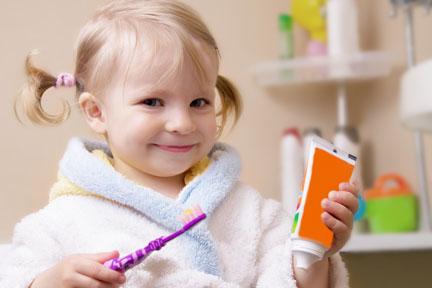 Little girl holding toothbrush